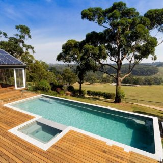 Achieve a similar effect with your pool design if you have a sloping site