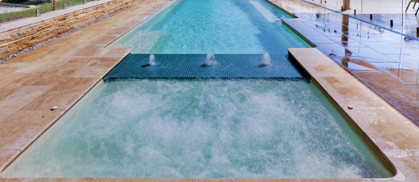 The Pool People Lap pool with a spa sundeck and water features